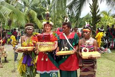 PNG volunteer Jessica Bensemann, dressed in her official Women and Youth in Agriculture Meri blaus, complete with Tolai Blias (decoration), formally presents the WYiA strategic plan to the East New Britain Provincial Government, PNG.
