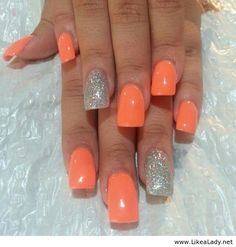 Long orange nails with silver accents