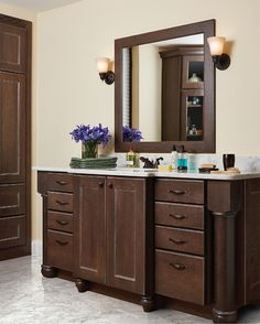 High design isn't just for the kitchen.  This Allen door style vanity in Oak with Slate Black Glaze finish wishes it could admire itself in the mirror. #norcraftcabinetry