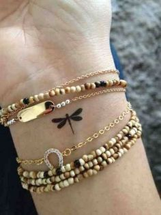"32 #Inspiring Wrist Tattoos ... | i like it but, uh, how is a tiny dragonfly tattoo ""inspiring""? lmao ~not you"