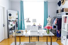 studio - white furniture with aqua curtains