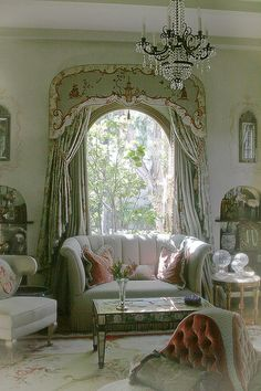 arched picture window framing a spectacular view with absolutely gorgeous window coverings and a fabulous color palette