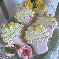 Pale pink and white stripe cupcake papers, pale yellow icing, yellow roses; exquisite artist, Teri Pringle Wood