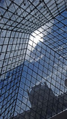 Louvre, Paris, France.  Architect of glass structure Chinese-American IM Pei.