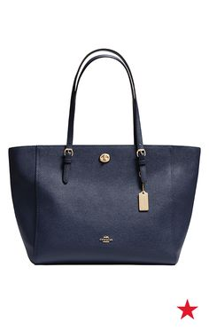 We're definitely feeling this true blue Coach tote. With a relaxed blouse, a pair of cuffed boyfriend jeans and some cute open-toe booties... that's effortless style.