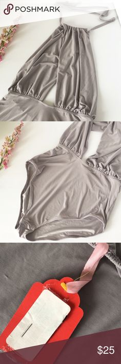 Gray Dawn Halter Bodysuit New with tags . Unknown brand from nasty Gal. Nasty Gal Tops