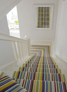 If you keep the rest of your hallways white, you can afford to be more adventurous with your stair runner. This striped carpet would add an elegant touch to any stairway.