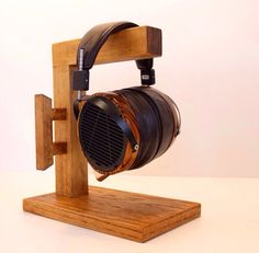 DIY Headphone Stand - Build a cool headphone hanger to get your over-the-ear headphones off your desk and keep them safe when you're not using them. Want to build them? Well we have some DIY Headphone Stand Ideas for you. Diy Headphone Stand, Headphone Storage, Headphone Splitter, Headphone Holder, Cordless Headphones, Cheap Headphones, Best Headphones, Wood Phone Holder, Headset Holder