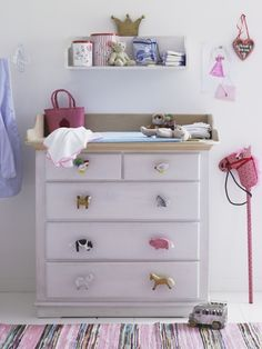 Update a plain dresser with personality. Choose accents that work with a color palette or a theme that your child is wild for.
