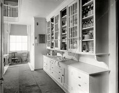 From Shorpy: Executive Pantry: 1909. I just love the brackets on this one. And look at that little cabinet on the far wall--I wonder if it was used to store spices.