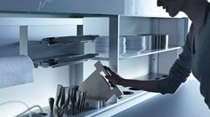 :: heart :: Valcucine Vetro Kitchen - For the ultra modernist who loves to live in a concrete box, beautiful integrated storage solutions with minimal detailing - love the cutting boards
