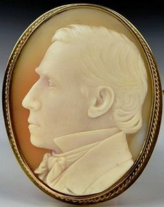 Shell cameo of Victorian gentleman in high collar & bowtie.  Artist, B.H. Kinney; sitter unknown.