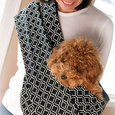 The Pet Sling Keeps Your Little Dog Close to Your Heart... A necessary accessory for every small dog owner, no doubt