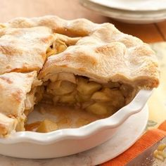 Cinnamon, allspice and nutmeg dress up the all-American apple pie just in time for fall. Serve with vanilla bean ice cream for a dreamy dessert plate. Get the recipe for Spiced Apple Pie Apple Pie Recipes, Pastry Recipes, Dessert Recipes, Cooking Recipes, Spiced Apples, Baked Apples, Holiday Pies, Holiday Recipes, American Apple Pie
