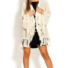 We love fringe!! Get this cute fringe cardigan now at www.thespottedzebrastore.com #onlineboutique #fringe #cardigan