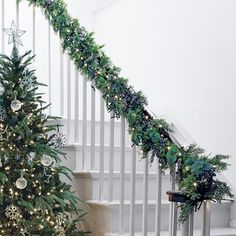 The White Company | Eucalyptus & Winterberry Garland. n our bestselling size, this beautiful festive garland sets a stylish and welcoming tone. What makes it so special is that every piece has been individually selected and placed by expert florists. Pinning from the UK? -> http://www.thewhitecompany.com/Eucalyptus-and-Winterberry-Garland/p/WGHEG?swatch=Natural