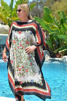 Beautiful floral caftan set off by its black, mixed patterned border, in a soft, cotton poly blend fabric. Great beach or pool wear or everyday lounging. 51 inches wide and 51 inches long. Unique Resume, Pool Wear, Kaftan Tops, Kaftans, Sheer Fabrics, Daily Look, Evie, Cover Up, Plus Size