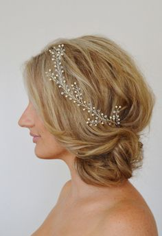 Item # HV-018: This listing is for one Clear AB crystal and Swarovski pearl bridal hair vine.This hair vine is very versatile, it can be threaded around the head as shown or placed around the seam of a bun or updo. It is lightweight and flexible and has little loops on each end so