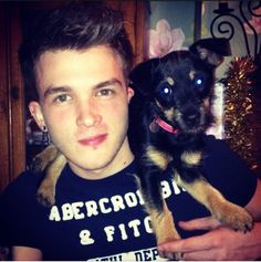 Josh Divine, the One Direction drummer holding a doggie. :)