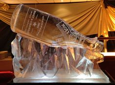 Moet champagne bottle ice sculpture with an ice luge Roaring 20s Party, 1920s Party, Gatsby Party, Party Party, Snow And Ice, Fire And Ice, Ice Sculpture Wedding, Ice Luge, New Year's Eve 2020