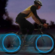 Kit de 2 luces de bicicleta, se activan con el movimiento y en reposo se apagan. Se colocan en la válvula de la rueda. Colores a elección.