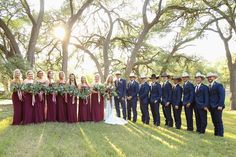 Savannah + Jon Paul   Maroon, Navy, Coral & Gold Rustic Wedding    The couple wed atLa Estancia Bella, a charming 100-acre cattle ranch with a custom-built barn venue and expansive views of the Texas Hill Country.  Photo: Dunlap Photography   #countrychic #barnwedding #weddingvenue #rustic #country #cowboy #barn #western #barnreception #texanwedding #outdoorceremony #indoorreception #countryvenue #laceweddingdress #maroonwedding #greenery #eucalyptus