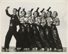 """Smile and wave!  Here choreographer and producer Donn Arden poses with a line of chorus girls sometime during the 1940s.  Part of the UNLV Libraries """"Showgirls"""" digital collection.  #UNLV"""