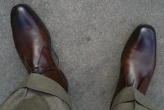 A bird's eye perspective of DocHolliday's shoes along with his mole-skin-looking olive pair of pants.