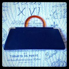 """1950s Vintage Navy Blue Purse Vintage chic handbag. Navy blue leather like material, gold tone hardware, amber colored lucite handle. Average vintage wear to handle and metal. Overall good condition.  13.5"""" by 5"""" and 1.5-2"""" deep when closed. Vintage Bags Mini Bags"""