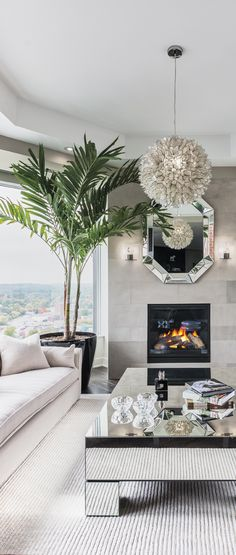 Living Room, mirror table, fireplace, & the sea view