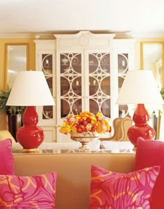 """Designer Amanda Nisbet mixed elegance and comfort in her New York living room, along with a dash of bling: """"I want to eat Christopher Spitzmiller's lamps, they're so juicy!"""" In the background between the two lamps, the white-painted Cherington bookcase from William Yeoward."""