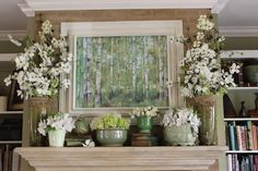 Spring mantel with greens and white. Flowers include real and silk dogwood, tulips, hydrangea, & azaleas.