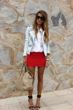 Washed out denim jacket and a red skirt.