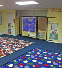 Versare Wall-Mounted Room Divider 360s are seen collapsed and neatly tucked away in this daycare center to allow more space for activities.