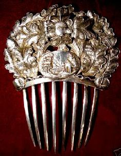 Victorian Sterling silver comb intricately decorated with oak leaves and acorns, with an oval plaque carving of a house with trees at the base