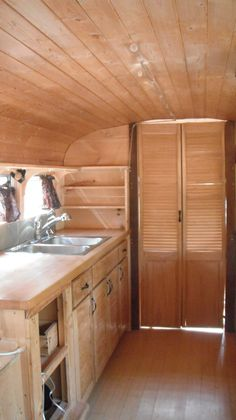 Kitchen view 1 of converted school bus