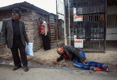 A Mozambican man lies in the street after he was reportedly stabbed by a mob in Alexandra township, Johannesburg, during fighting between locals and foreign nationals. Xenophobia South Africa, Jacob Zuma, Men Lie, Breaking News Today, Two Men, All News, Continents, Street Photography, Drinking