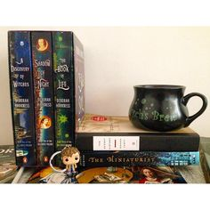 "We know what Shell H is talking about!  Those covers, those spines...it's hard to resist the visual allure of the All Souls Trilogy! And the story - forget about it!  Sold!  (And one of our Daemons is crazy for mugs...so look at that mug!)  She says on Instagram: ""My latest finds most likely being the last of my summer reading pile....the #allsoulstrilogy was a cover buy and I couldn't resist the story of witches."""