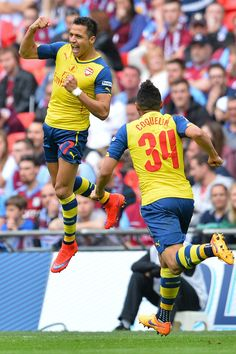 Alexis Sanchez celebrates after scoring during the FA Cup final football match between Aston Villa and Arsenal at Wembley stadium in London on May 30, 2015.