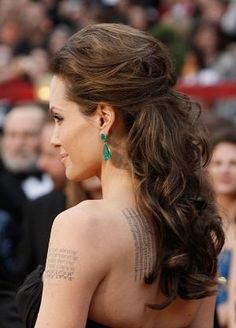 Angelina Jolie – Half Up Elegance. A style chic enough for a black tie wedding but perfect for the bride who also wants to let (some of) her hair down! Wedding Hairstyles, Celebrity Hairstyles by mandy