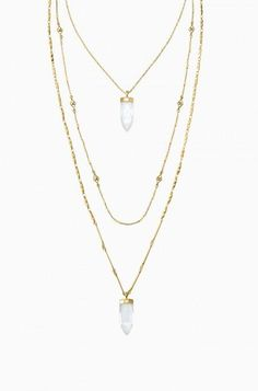 Semi-precious crackled quartz stones hang from three uniquely beautiful hand-made chains with gold plating. Wear the short chain alone or…