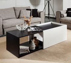 """VIG Furniture Modrest Elixir 35"""" Coffee Table with Expandable Feature and Two Tone in Black Oak/White Finish VGWCVP220A at appliancesconnection.com. The Modrest Elixir 35"""" Coffee Table is a beautiful two tone coffee table with a compact finish and expandable version. With it's unique elegance it is sure to be quit impressive to any living space. #extendable #hiddenstorage #fancymuch"""