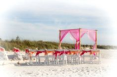 A backdrop of sea oats at Pass-a-Grille for this vibrant fuschia and tangerine Florida beach wedding by Suncoast Weddings