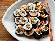 Korean Sushi Rolls with Walnut-Edamame Crumble | David Chang was inspired to make these playful rolls by a snack he had at Yunpilam, a temple in South Korea, where the nuns served him edamame mixed w...