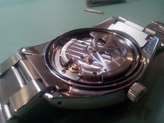 The back of a men's grand Seiko watch repaired at one of our branches.