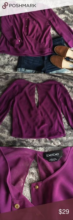 EUC Bebe Wrap Blouse EUC Bebe top!  Great details-gold snap buttons, 3/4 sleeve, keyhole back detail, faux wrap.   Fabric is sheer.  Sz xxs but could also work for a Sz XS.   Model is 32b/25 waist for reference.   Layer a nude cami or bandeau underneath w high waist shorts for a great day look💋 bebe Tops Blouses