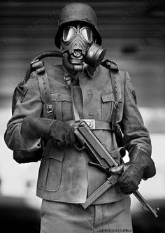 """Steven Spielberg looked to the past for inspiration when making his futuristic  science fiction trilogy, """"Star Wars"""". The Nazi uniforms and weapons were perfect prototypes for the militaristic """"Dark Side"""".  This old photo is a perfect example; one can easily imagine Darth Vader himself behind the gas mask."""