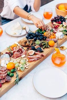 Make a beautiful cheese and charcuterie board your centerpiece so your guests can always keep snacking.