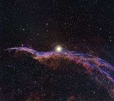 "Witch's Broom Nebula. It's part of the Veil Nebula (NGC 6960), the remains of a supernova that exploded more than 15,000 years ago.  The bright star (52 Cygnus) near the center of the image isn't associated with the supernova. (Credit: T. A. Rector / University of Alaska Anchorage and WIYN /NOAO/AURA/NSF) Mona Evans, ""Cosmic Halloween Tour"" http://www.bellaonline.com/articles/art52161.asp"