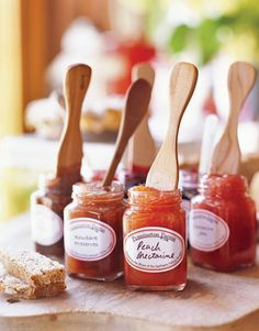 Pennington Farms jars of fresh peach nectarine and rhubarb preserves with wooden spoons